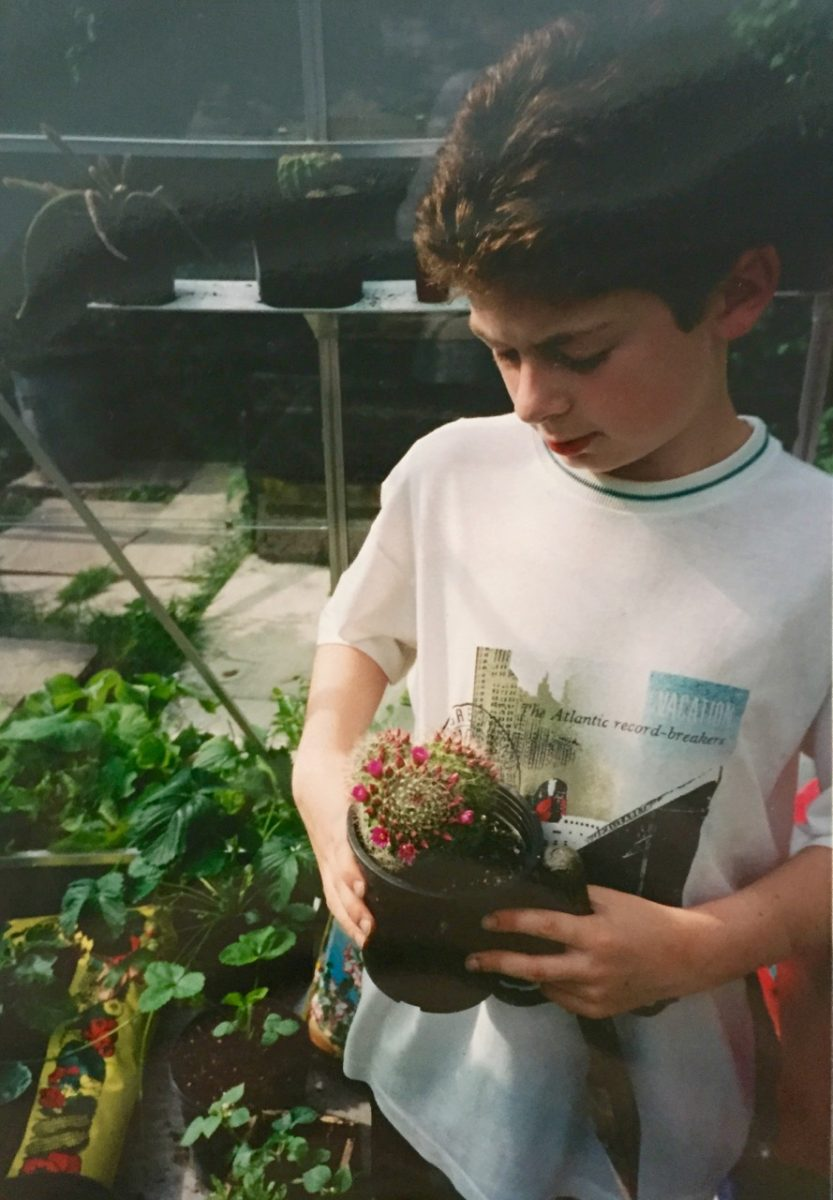 My parents recently found this photo of me as a boy in my greenhouse with some of my cacti collection