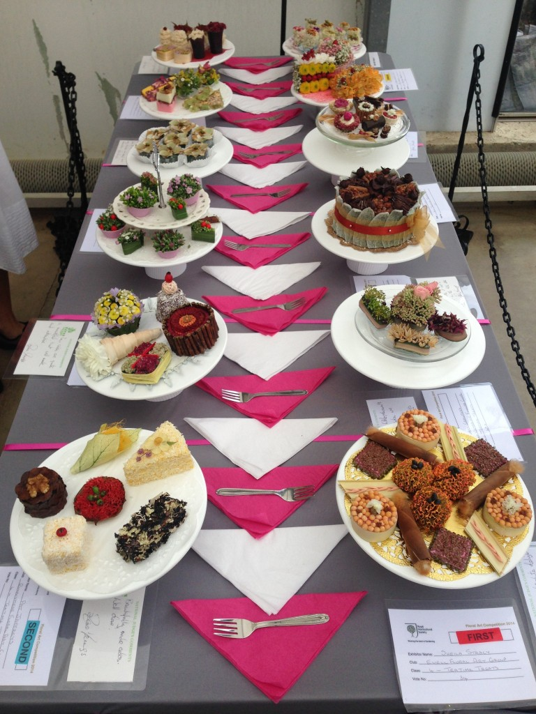 A table of cakes made entirely from flowers as part of the RHS Wisley Flower Show - don't eat them!