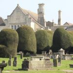 The 99 Topiary Yew Trees of St. Mary's church in Painswick, Cotswolds